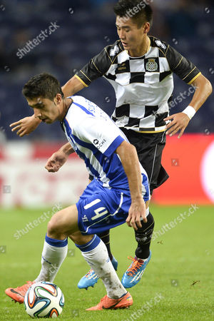 Fc Porto's Jose Angel (l) Vies For the Ball with Boavista's Wei Shihao During the Portuguese First League Soccer Match Between Porto and Boavista Held at Dragao Stadium in Porto Portugal 21 September 2014 Portugal Porto