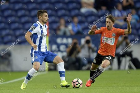 Fc Porto's Alex Telles (l) Vies For the Ball with Boavista?s Medeiros During Portuguese League Soccer Match at Dragao Stadium in Porto Portugal 23 September 2016 Portugal Porto