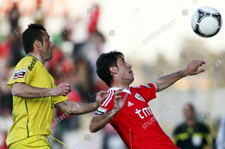 Benfica's Joan Capdevila (r) Vies For the Ball with Manuel Jose (l) of Pacos De Ferreira During Their Portuguese First League Soccer Match at Mata Real Stadium in Pacos De Ferreira Portugal 11 March 2012 Portugal Pacos De Ferreira