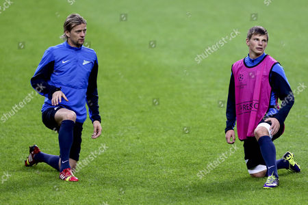 Stock Image of Zenit St Petersburg's Anatoliy Tymoshchuk (l) and Andrei Arshavin Warm Up During a Training Session at Dragao Stadium in Porto Portugal 21 October 2013 Porto Will Host Zenit St Petersburg in a Uefa Champions League Group G Soccer Match on 22 October Portugal Porto