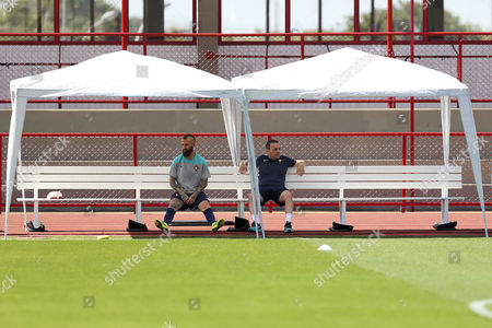 Portuguese National Soccer Team Head Coach Paulo Bento (r) and Player Raul Meireles Sit on a Bench During the Official Training Session at at the Centro De Capacitacao Fisica Dos Bombeiros in Brasilia Brazil 25 June 2014 Portugal Faces Ghana For a Fifa World Cup 2014 Group G Preliminary Round Match at the Estadio National in Brasilia Brazil on 26 June 2014 Brazil Brasilia