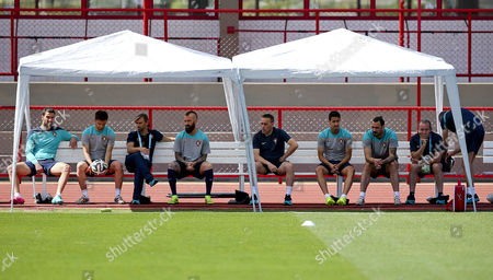 (l-r) Portuguese Players Goalkeeper Rui Patricio Forward Helder Postiga Portuguese National Football Federation Vice-president Joao Pinto Midfielder Raul Meireles Head Coach Paulo Bento Defender Andre Almeida and Forward Hugo Almeida Sit on a Bench During the Official Training Session at at the Centro De Capacitacao Fisica Dos Bombeiros in Brasilia Brazil 25 June 2014 Portugal Faces Ghana For a Fifa World Cup 2014 Group G Preliminary Round Match at the Estadio National in Brasilia Brazil on 26 June 2014 Brazil Brasilia