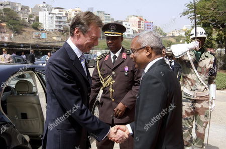 Henri Grand Duke of Luxembourg (l) Greets the Prime Minister of Cape Verde Jose Maria Neves (r) Upon His Arrival For a Meeting at the Government Palace in Cidade Da Praia Cape Verde 10 March 2015 the Duke Will Visit the African Country For Three Days Cape Verde Cidade Da Praia