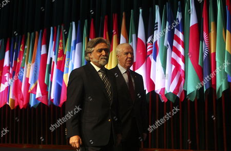 Stock Image of Outgoing Portuguese Foreign Minister Luis Amado (l) and Finance Minister Teixeira Dos Santos (r) Walk After the Formal Opening Ceremony of the Annual Meeting of the African Development Bank Held at the Congress Centre of Lisbon 9 June 2011 Business Leaders Government Representatives From 77 Countries and International Institutions Are Involved in the Annual Meeting of the African Development Bank Which Ends Next 10 June 2011 Portugal Lisbon