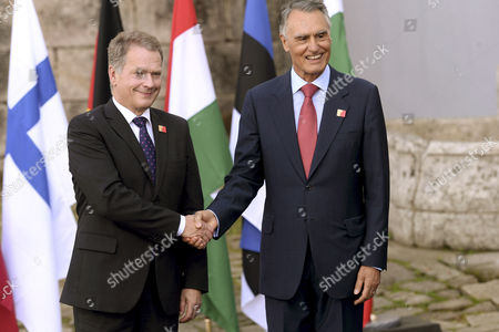 Portuguese President Anibal Cavaco Silva (r) Shakes Hands with Finnish President Sauli Vainamo Niinisto (l) During a Welcome Ceremony of the Arraiolos Group Meeting at the Mosteiro De Tibaes in Braga Portugal 29 September 2014 the Meeting is Held Between the Eu's Parliamentary Democracies' Heads of States with Italian and Slovenian Presidents not Present Portugal Braga