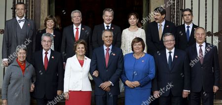 (top Row L-r) Estonian President Toomas Hendrik Ilves Daniela Schadt Her Partner German President Joachim Gauck Finnish President Sauli Niinisto Anita Herczegh and Her Husband Hungarian President Janos Ader Bulgarian President Rosen Plevneliev (bottom Row L-r) Margit Fischer and Her Husband Austrian President Heinz Fischer Maria Cavaco Silva and Her Husband Portuguese President Anibal Cavaco Silva Anna Komorowska and Her Husband Polish President Bronislaw Komorowski and Latvian President Andris Berzins During Line Up For a Family Photo at the Arraiolos Group Meeting at the Mosteiro De Tibaes in Braga Portugal 29 September 2014 the Meeting is Held Between the Eu's Parliamentary Democracies' Heads of States with Italian and Slovenian Presidents not Present Portugal Braga