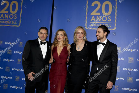 Stock Picture of (l-r) Douro Azul Owner Mario Ferreira His Wife Paula Paz Dias Us Actress Sharon Stone and Her Boyfriend Martin Mica Pose For Photograph As They Attend the Douro Azul's 20th Anniversary Event in Porto Portugal 22 March 2013 Sharon Stone Will Be the Godmother of the Douro Azul New Ship the Portuguese Cruise Company Organizes Tours Along Portugal's Douro River Valley Portugal Porto
