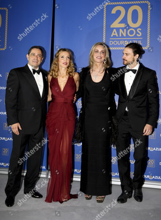 (l-r) Douro Azul Owner Mario Ferreira His Wife Paula Paz Dias Us Actress Sharon Stone and Her Boyfriend Martin Mica Pose For Photograph As They Attend the Douro Azul's 20th Anniversary Event in Porto Portugal 22 March 2013 Sharon Stone Will Be the Godmother of the Douro Azul New Ship the Portuguese Cruise Company Organizes Tours Along Portugal's Douro River Valley Portugal Porto