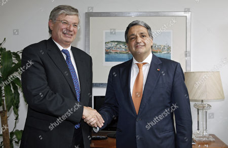 Portuguese Health Minister Paulo Macedo (r) and European Commissioner For Health and Consumer Policy Maltese Tonio Borg (l) Shake Hands During Their Meeting in Lisbon Portugal 23 June 2014 Portugal Lisbon