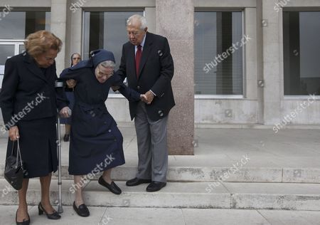 Stock Picture of Former Portuguese President Mario Soares (r) and His Wife Maria Barroso (l) Help a Nun Down the Stairs After Voting For the Portuguese General Elections in Lisbon Portugal 27 September 2009 the Portuguese Cast Their Votes on 27 September in an Election where the Ruling Socialists Are Expected to Win Thought Possible That the Winning Party Might Have to Form a Minority Government a Situation Which Could Create Political Instability and Uncertainty at a Time when Strong Policies Were Needed to Cope with the Crisis Portugal Lisboa