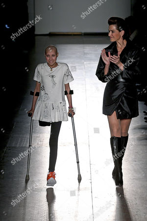 A Young Girl with Cancer Walks on the Runway with Model Sofia Aparicio (r) Presenting a Creation of Portuguese Fashion Designer Filipe Faisca with the Participation of Nine Girls of the Cancer Portuguese Institute at the Moda Lisboa Fashion Week in Lisbon Portugal 15 March 2015 the Event Runs From 13 to 15 March Portugal Lisbon