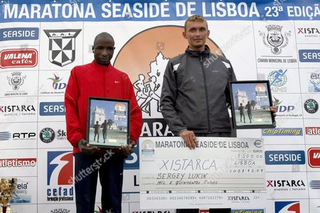 Lisbon Marathon Winner Russian Sergey Lukin (r) and Second-placed Johnstone Chebi (l) of Kenya Celebrate on the Podium Following the 23rd Lisbon Marathon in Lisbon Portugal on 07 December 2008 Third-placed British James Lawler Did not Show Up at the Podium Ceremony Portugal Lisbon