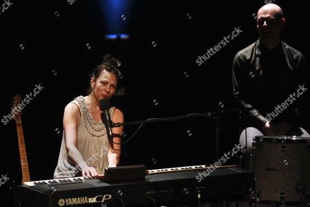 Stock Photo of Us Singer Lisa Germano (l) and English Musician Philip Selway (r) Member of British Band Radiohead Perform at the Cultural Centre of Belem in Lisbon Portugal 06 April 2010 Portugal Lisbon