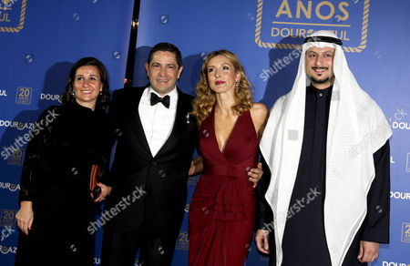 Douro Azul Owner Mario Ferreira (2-l) His Wife Paula Paz Dias (2-r) Saleh Al-quaiti Owner of Manchester City Soccer Club (r) and an Unidenitifed Guest Arrive For the Douro Azul's 20th Anniversary Event in Porto Portugal 22 March 2013 Sharon Stone Will Be the Godmother of the Douro Azul New Ship the Portuguese Cruise Company Organizes Tours Along Portugal's Douro River Valley Portugal Porto