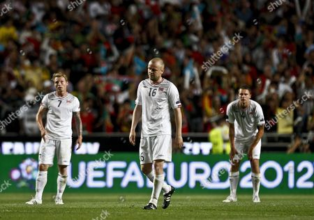 Norway Players Bjorn Helge Rise (l) Christian Grindheim (c) and Vadim Demidov Look Disappointed at the End of Their Group H Euro 2012 Qualifying Game Against Portugal at Luz Stadium in Lisbon Portugal 04 June 2011 Portugal Lisbon