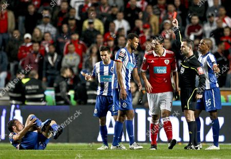Benfica Player Cardozo (c) Receives a Red Card Given by the Referee Duarte Gomes During the Portuguese First League Soccer Match Against Fc Porto Held at Luz Stadium in Lisbon Portugal on 03 April 2011 Portugal Lisboa