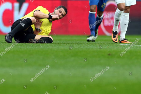Stock Picture of The Referee Manuel Mota Falls After Crashing Against a Player During the Portuguese First League Soccer Match Between Fc Porto and Academica Held at Dragao Stadium in Porto Portugal 06 April 2014 Portugal Porto