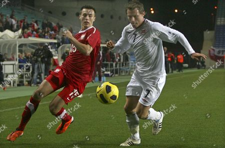 Adam Matuszczyk (l) of Poland Vies For the Ball with Bjorn Helge Riise (r) of Norway During Their International Friendly Soccer Match at Algarve Stadium in Faro Portugal 09 February 2011 Poland Won 1-0 Portugal Faro