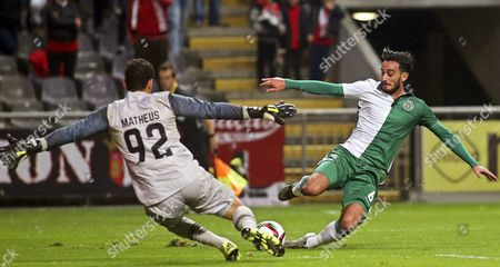 Sporting Braga's Goalkeeper Matheus (l) in Action Against Sporting Lisbon's Alberto Aquilani (l) During the Portuguese Cup Round of 16 Soccer Match Between Sporting Braga and Sporting Lisbon in Braga Northern Portugal 16 December 2015 Portugal Braga