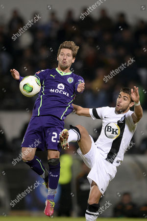 Guimaraes Player Joao Amorim (r) Fights For the Ball with Adrian Silva of Sporting During the Portuguese First League Match Held at D Afonso Henriques Stadium Guimaraes Portugal 24 November 2013 Portugal Guimaraes