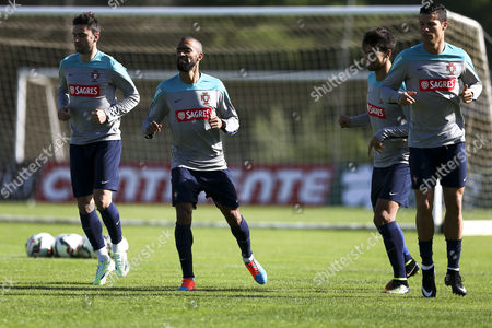 Portugal National Team Players Helder Postiga (l) Jose Bosingwa (2l) Andre Gomes (2r) and Cristiano Ronaldo in Action During the Team's Training Session in Prepartation For the Upcoming Euro 2016 Group i Qualifying Match Against Armenia at Vale Do Garrao South of Portugal 11 November 2014 Portugal Faro