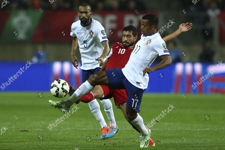 Portugal Players Jose Bosingwa and Nani (r) Vie For the Ball with Gevorg Ghazaryan (c) of Armenia During the Uefa Euro 2016 Qualifying Soccer Match Between Portugal and Armenia at Algarve Stadium in Faro Southern Portugal 14 November 2014 Portugal Faro