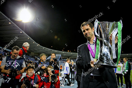 Wolfsburg's Head Coach Ralf Kellermann Poses For Photographers with the Uefa Women's Champions League Trophy After Beating Tyres÷ Ff at Restelo Stadium in Lisbon Portugal 22 May 2014 Portugal Lisbon