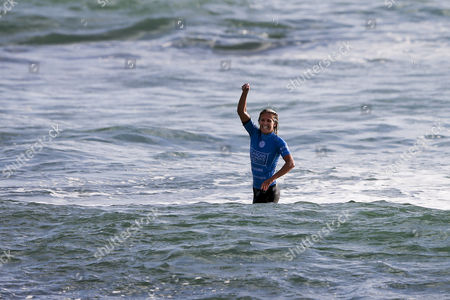 Australian Surfer and New Leader of the World Ranking Stephanie Gilmore Jubilates After Winning the Cascais Women's Pro at Carcavelos Beach Portugal 05 October 2014 Portugal Cascais
