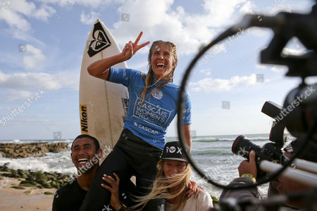 Australian Surfer and New Leader of the World Ranking Stephanie Gilmore Jubilates As She is Carried After Winning the Cascais Women's Pro at Carcavelos Beach Portugal 05 October 2014 Portugal Cascais