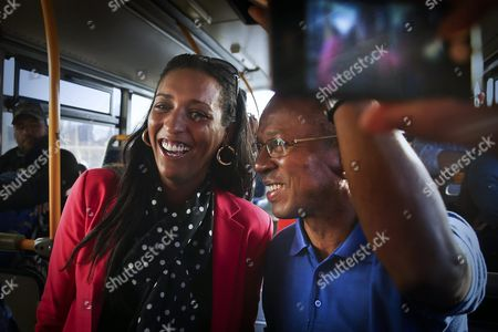 The Movement For Democracy (mpd) Party Leader and Candidate Ulisses Correia E Silva (r) Speaks with His Opponent From African Party For the Independence of Cape Verde (paicv) President and Candidate Janira Hopffer (l) As They Travel on an Airport Bus to Catch a Flight to Santiago Island on the Last Day of Campaign For the Legislative Elections at Cesaria Evora International Airport in Sao Vicente Island Cape Verde 18 March 2016 Cape Verde Will Hold Legislative Elections on 20 March Cape Verde Mindelo