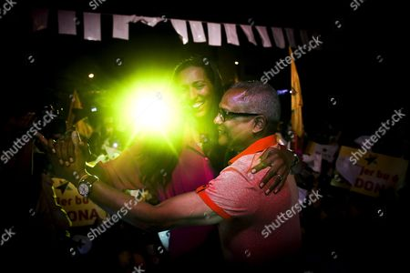 Stock Picture of African Party For the Independence of Cape Verde (paicv) President Janira Hopffer Almada (l) Dances with Cape Verde's Prime Minister Jose Maria Neves (r) During a Political Rally For the Upcoming Legislative Elections in Praia City Santiago Island Cape Verde 15 March 2016 Cape Verde Will Hold Legislative Elections on 20 March Cape Verde Praia City