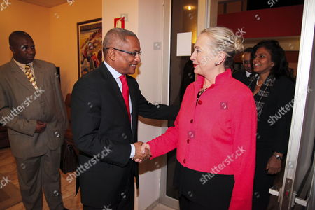 Us Secretary of State Hillary Rodham Clinton (r) is Welcomed by Jose Maria Neves Prime Minister of Cape Verde During Her Visit to the Island 17 January 2012 at Sal International Airport in Cape Verde Cape Verde Sal International Airport