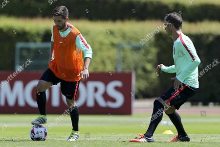 Portugal's Joao Moutinho (l) and Ricardo Carvalho (r) During a Training Session at the French National Rugby Team's Camp in Marcoussis Near Paris France 07 July 2016 the Prevous Day Portugal Defeated Wales in the Uefa Euro 2016 Semi-finals France Paris