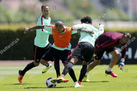 Portugal's Ricardo Carvalho (l-r) Ricardo Quaresma Eliseu and Eduardo in Action During a Training Session at the French National Rugby Team's Camp in Marcoussis Near Paris France 07 July 2016 the Prevous Day Portugal Defeated Wales in the Uefa Euro 2016 Semi-finals France Paris