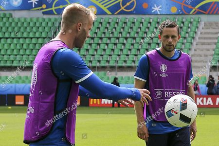 Iceland National Soccer Team Players (l-r) Eidur Gudjohnsen Gylfi Sigurdsson During the Training Session at Stade Geoffroy Guichard in Saint-etienne in Preparation For Tomorrows Match Against Portugal Group F of Euro 2016 in Saint-etienne France 13 June 2016 (restrictions Apply: For Editorial News Reporting Purposes Only not Used For Commercial Or Marketing Purposes Without Prior Written Approval of Uefa Images Must Appear As Still Images and Must not Emulate Match Action Video Footage Photographs Published in Online Publications (whether Via the Internet Or Otherwise) Shall Have an Interval of at Least 20 Seconds Between the Posting ) Epa/miguel a Lopes France Saint-etienne
