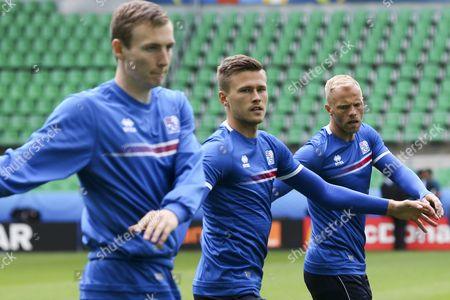 Iceland National Soccer Team Players (l-r) Jon Dadi Bodvarsson Arnor Ingvi Traustason Eidur Gudjohnsen During the Training Session at Stade Geoffroy Guichard in Saint-etienne in Preparation For Tomorrows Match Against Portugal Group F of Euro 2016 in Saint-etienne France 13 June 2016 (restrictions Apply: For Editorial News Reporting Purposes Only not Used For Commercial Or Marketing Purposes Without Prior Written Approval of Uefa Images Must Appear As Still Images and Must not Emulate Match Action Video Footage Photographs Published in Online Publications (whether Via the Internet Or Otherwise) Shall Have an Interval of at Least 20 Seconds Between the Posting ) France Saint-etienne