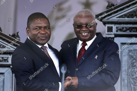 Mozambique's New President Filipe Nyusi (l) and Outgoing President Armando Guebuza (r) Holding Hands During the Inauguration Ceremony at the Praca Da Independencia (independence Square) in Maputo Mozambique 15 January 2015 Filipe Nyusi From the Ruling Frelimo Party was Elected Last October As the Southern African Country's Fourth President Since Its Independence in 1975 Mozambique Maputo