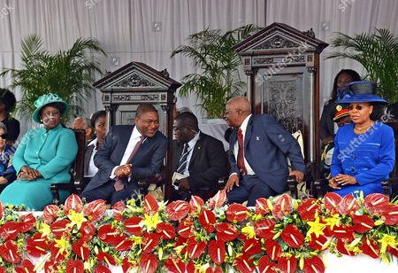 Mozambique's New President Filipe Nyusi (c-l) His Wife Isaura Nyusi (l) the Outgoing President Armando Guebuza (c-r) and His Wife Maria Da Luz Guebuza (r) Attend the New President's Inauguration Ceremony at Pra?a Da Independencia (independence Square) in Maputo Mozambique 15 January 2015 According to Local Reports Filipe Nyusi From the Ruling Frelimo Party who was Elected Last October with 57 Percent of the Vote Headed the New Parliament Which Sat For the First Time 12 January But the Country Has Suffered a Number of Political Set Backs Including From Opposition Renamo Leader Alfonso Dhlakama who As Part of a Tactic to Improve His Bargaining Position Threatened to Declare Himself President of a Seperate Republic of Central and Northern Mozambique Mozambique Maputo