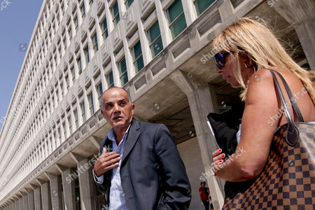 Stock Photo of The Former Portuguese Police Chief Goncalo Amaral (c) Leaves the Courthouse Accompanied by His Lawyer Isabel Gomes Da Silva (r) on the Second Day of the Trial where He is Accused of Libel by the British Couple Gerry and Kate Mccann (not Pictured) Parents of the British Child Vanished in Portugal in 2007 in Lisbon Portugal 13 September 2013 According to Media Reports the Mccanns Began a Libel Action Over 'Devastating' Claims in a Book in Which the Former Police Chief Accuses the Parents of Covering Up Madeleine's Death Portugal Lisbon