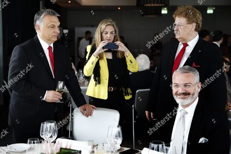 Hungarian Prime Minister and Fidesz President Viktor Orban (l) and Germany's Europan Parliament Deputy Elmar Brok (r) of the Christian Democratic Union (cdu) Party Arrive For a Lunch Within the Meeting of the Centrist Democrat International (cdi) Party at a Hotel in Lisbon Portugal 15 April 2016 Sitting (r) is Panama's Partido Popular and Cdi Vice President Milton Henriquez Others Are not Identified Portugal Lisbon