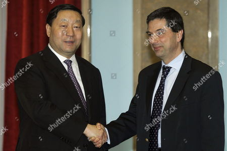 Portuguese Finance Minister Vitor Gaspar (r) Shake Hands with the President of State Grid Corporation of China (sgcc) Liu Zhenya (l) After a Signing Ceremony at the Finance Ministry in Lisbon Portugal 22 February 2012 State Grid Corporation of China (sgcc) Bought 25 Percent of Portuguese Power-grid Operator Ren- Redes Energeticas Nacionais (rene) Sa Portugal Lisbon