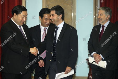 Portuguese Finance Minister Vitor Gaspar (c) Shake Hands with the President of State Grid Corporation of China (sgcc) Liu Zhenya (l) After a Signing Ceremony at the Finance Ministry in Lisbon Portugal 22 February 2012 Ceo of Ren Rui Cartaxo is Seen at the Right State Grid Corporation of China (sgcc) Bought 25 Percent of Portuguese Power-grid Operator Ren- Redes Energeticas Nacionais (rene) Sa Portugal Lisbon