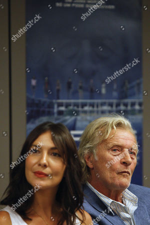 Stock Picture of Dutch Actor/cast Member Rutger Hauer (r) and Portuguese Actress/cast Member Soraia Chaves Attend a Press Conference For 'Real Playing Game' (aka Rpg) in Lisbon Portugal 20 August 2013 the Science Fiction Movie Will Be Released in Portuguese Theaters on 29 August Portugal Lisbon