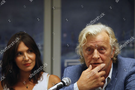 Stock Image of Dutch Actor/cast Member Rutger Hauer (r) and Portuguese Actress/cast Member Soraia Chaves Attend a Press Conference For 'Real Playing Game' (aka Rpg) in Lisbon Portugal 20 August 2013 the Science Fiction Movie Will Be Released in Portuguese Theaters on 29 August Portugal Lisbon