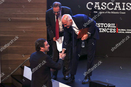 Former Prime Minister of Greece Georgios Papandreou (r) Greets Portuguese Prime Minister Pedro Passos Coelho (l) at the End of His Talk During the Estoril Conferences at the Estoril Congress Center Estoril Outskirts of Lisbon Portugal 20 May 2015 the Conference Runs Untill 22 May Portugal Lisbon