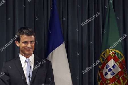 Stock Picture of French Prime Minister Manuel Valls and His Portuguese Counterpart Pedro Passos Coelho (not Pictured) Speak to the Journalists During a Press Conference After Their Meeting at Sao Bento Palace in Lisbon Portugal 10 April 2015 Manuel Valls is on a One Day Visit to Lisbon Portugal Lisbon