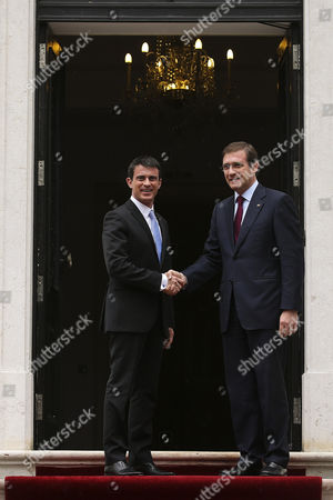 Stock Photo of France's Prime Minister Manuel Valls (l) Greets His Portugal's Counterpart Pedro Passos Coelho (r) As He Arrives For a Meeting at the Sao Bento Palace in Lisbon Portugal 10 April 2015 Valls is on a One Day Visit to Lisbon Portugal Lisbon
