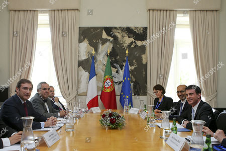 France's Prime Minister Manuel Valls (r) with His Portuguese Counterpart Pedro Passos Coelho (l) and Their Respective Delegations Sit For Talks at the Sao Bento Palace in Lisbon Portugal 10 April 2015 Valls is on a One Day Visit to Lisbon Others Are not Identified Portugal Lisbon