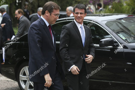 France's Prime Minister Manuel Valls (r) is Accompanied by His Portuguese Counterpart Pedro Passos Coelho (l) As They Arrive For a Meeting at the Sao Bento Palace in Lisbon Portugal 10 April 2015 Valls is on a One Day Visit to Lisbon Portugal Lisbon