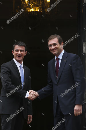 Stock Image of France's Prime Minister Manuel Valls (l) Greets His Portugal's Counterpart Pedro Passos Coelho (r) As He Arrives For a Meeting at the Sao Bento Palace in Lisbon Portugal 10 April 2015 Valls is on a One Day Visit to Lisbon Portugal Lisbon